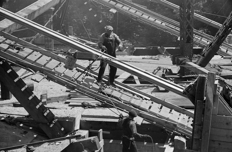 Worker on catwalk of the Lions Gate Bridge under