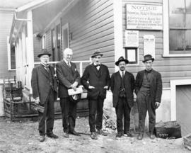 [Men in front of the Capilano Water works Intake building]