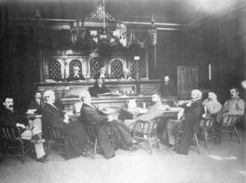 [The justices and officials of The Court of Appeal in a court room]