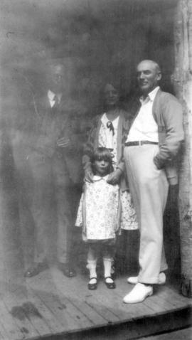 [L.D. Taylor standing with George J., Annie and Beverly Fowler]
