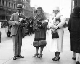 [Mayor L.D. Taylor with two women canvassing for the Crippled Childen's Fund downtown]
