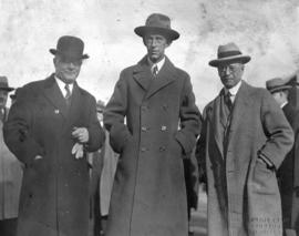 [Group portrait of L.D. Taylor with two men at outdoor gathering]