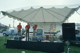 Band performing on Chevron stage during Vancouver AM sign unveiling at Oak Street and 71st Avenue
