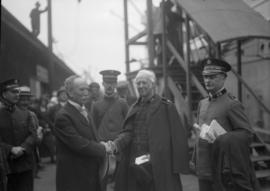 A man shaking hands with a Salvation Army official