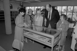 City Archivist Sue Baptie shows an exhibit to Mayor Michael Harcourt and members of the Vancouver...