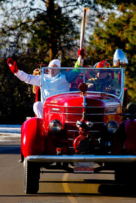 Day 89 Torchbearer 74 Lawrence Skolrood carries the flam on an antique fire truck in Coldstream, ...