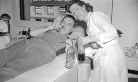 [Portrait of R.J. O'Leary and a nurse at a blood donor clinic]