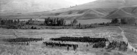 [View of an inspection of the 62nd Battalion near the training camp]
