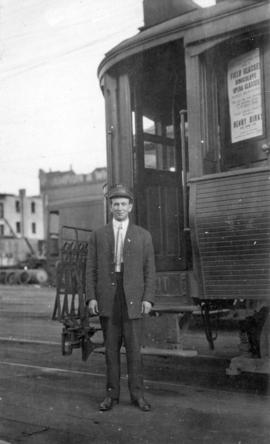 [Joseph A. Byron, Motorman No. 141 beside the front of streetcar No. 172 at the Prior Street car ...