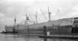 S.S. Valhall [at dock, with barge alongside]
