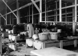 Japanese Canadian women and children in Restaurant building, Building D, doing laundry during Jap...