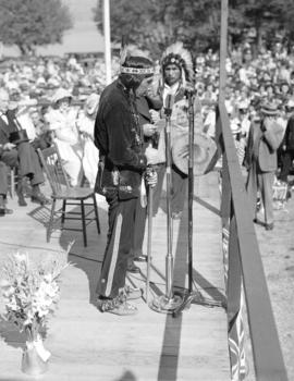 [August Jack Khatsahlano addressing the crowd at the rededication of Stanley Park]