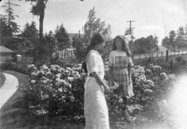 [Two girls in the garden of Mrs. J.Z. Hall's residence  - 2890 Point Grey Road]