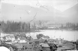 [View of downtown houses, part of Stanley Park, and the North Shore mountains from Burrard and Du...