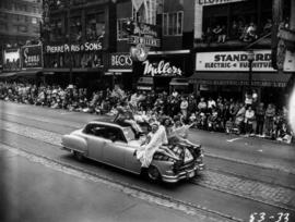 Women and clowns on car in 1953 P.N.E. Opening Day Parade
