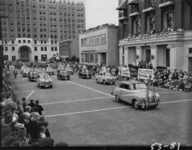 Cars advertising P.N.E. program prizes in 1953 P.N.E. Opening Day Parade