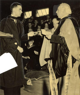 Judge F.W. Howay, presenting an award at U.B.C. to law student William Maurice Sibley