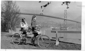Patricia Beckett and Nancy Wherley with tandem bicycle in Stanley Park