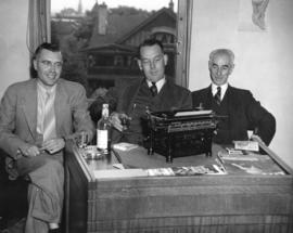 [Alan Jessup, Cliff MacKay and A. Cromar Bruce in the City Hall Press Room]