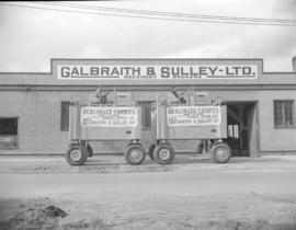 [Gerlinger carriers in front of Galbraith & Sully Ltd., machinery broakers]