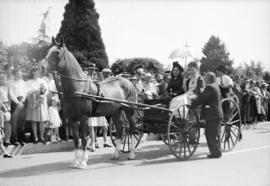 [Mrs. David Oppenheimer and others in a horse drawn carriage at the rededication of Stanley Park]