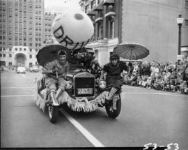Clowns on car in 1953 P.N.E. Opening Day Parade