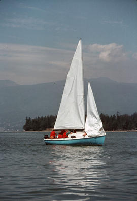 Sailboat in Burrard Inlet with Stanley Park and North Shore mountains in background