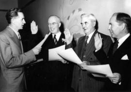 [Ron Thompson, City Clerk swearing in Earle G. Adams, W.G. Calder and John Moffitt as Park Commis...