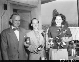 CKNW host with man and woman holding Rose brand pickle products