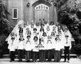 Junior choir at Immaculate Conception [Catholic Church] showing trophy from Kiwanis Music festival