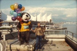 Tillicum and unidentified man in front of Canada Place