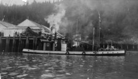 "Fishing scow ""Fir Leaf"" at wharf of cannery"