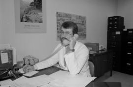Archivist Ken Young on the phone at the City of Vancouver Archives