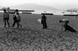 Girl Guides picking up litter from beach