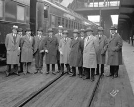 [Rear Admiral Campbell and group at train station]