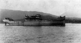 Dismantled U.S. Shipping Board freighter being towed from Barnston Is[land] to scrap at Bidwell B...