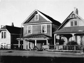 "[View of three ""old"" houses. Centre one, 747 East Pender Street]"