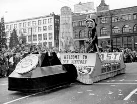 [The British Columbia Telephone Company float travelling past the cenotaph in the Grey Cup Parade]