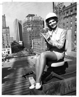 Shirley Hayzel posing atop steelwork of Toronto Dominion Bank Tower at Granville and Georgia