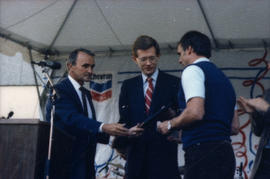 George Puil handing award to two men