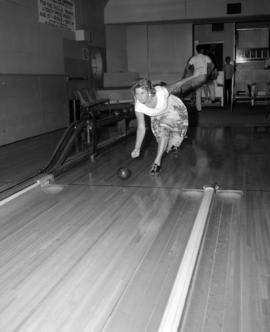 [Bowler in action]