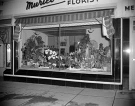 [Flower and plant display in the window of Muriel Skae Florist]
