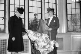 [Mrs. Wendell Farris and Mrs. R.V. Stuart helping to decorate the airmen's convalescent home]