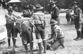 [Boy scouts demonstrate first aid to General Baden-Powell at Hastings Park]