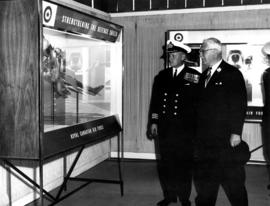 Lieutenant Governor G.R. Pearkes with R.C.N. officer at Armed Forces of Canada exhibit on P.N.E. ...