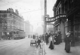 [Granville Street near Pender Street, looking north, showing sign for Semi-Ready Tailoring]