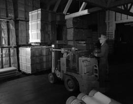 [Men operating a forklift at] Pacific Mills