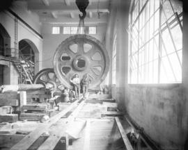 [Two men in partially constructed generator room for Buntzen Lake Power Plant number two