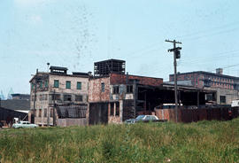[View looking north west to Gore Avenue showing vacant and dilapidated buildings at 308 E Georgia...