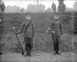 [Two high school officer cadets in full uniform]